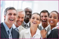 Group of successful business colleagues laughing together