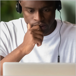 Focused,African,Student,Wear,Headphones,Studying,On-line,Do,Exercise,Using
