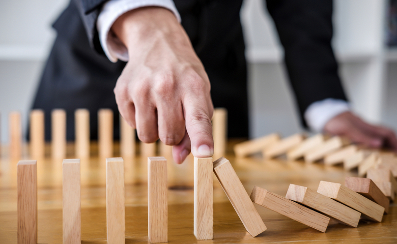 Wooden,Game,Strategy,,Businessman,Hand,Stopping,Falling,Wooden,Dominoes,Effect